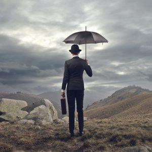 man-with-umbrella-PYC74UV